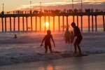 Huntington Beach Pier at Sunset…the weather is sultry, the kids are joyfully playing.